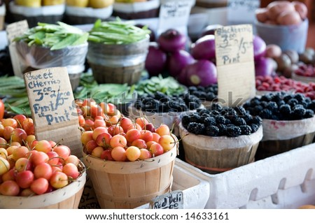 An image of a variety of fruits and vegetables at an outdoor farmer's market - stock photo