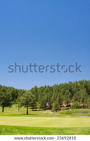 An image of a vibrant golf hole in Arizona - stock photo