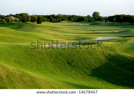 An image of a vibrant green golf course - stock photo