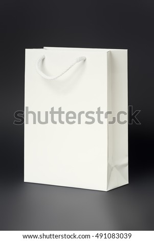 An image of a white shopping bag on a black background