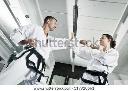An image of a woman and a man fighting - stock photo