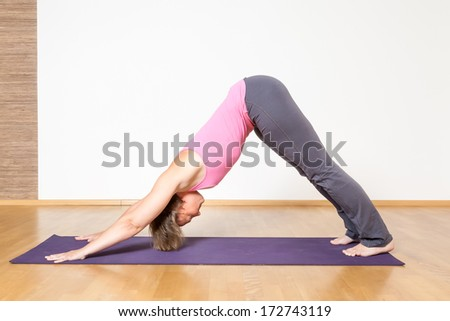An image of a woman doing yoga - stock photo
