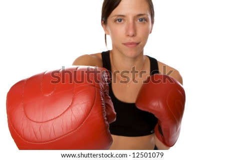 An image of a woman in gym clothes, with boxing gloves, strength and fitness