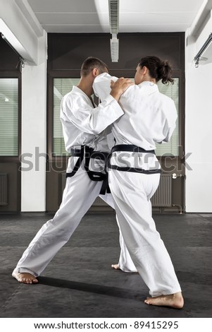 An image of a women and a man fighting - stock photo