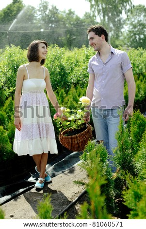 An image of a young couple with a basket with roses