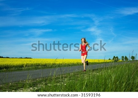 An image of a young girl running on the road