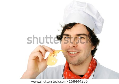 An image of a young happy chef with cheese - stock photo