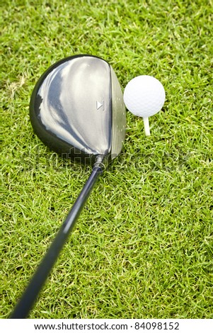 An image of a young male golf ball on green - stock photo