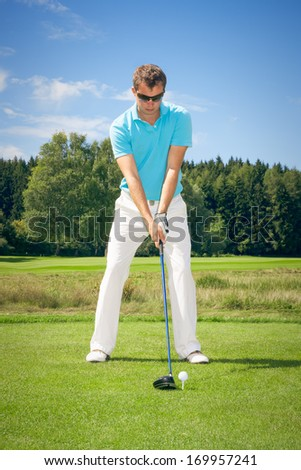 An image of a young male golf player - stock photo