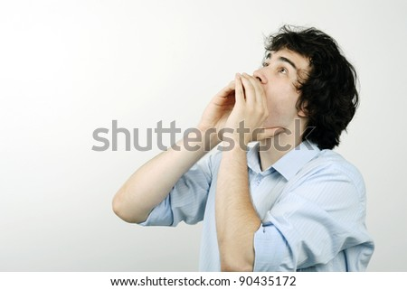 An image of a young man screaming - stock photo