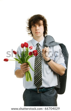 An image of a young man with red tulips