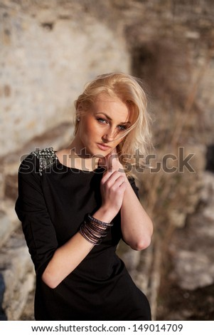An image of a young pretty blond girl outside