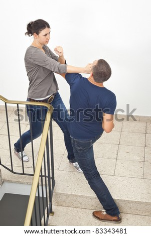 An image of a young woman fighting with a man - stock photo