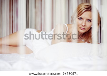 An image of a young woman in a bed