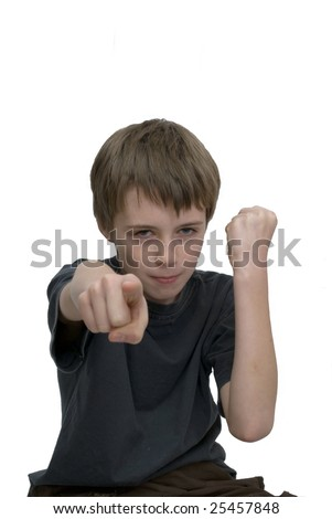 an image of an aggressive young boy with clenched fist and finger pointing forwards. - stock photo