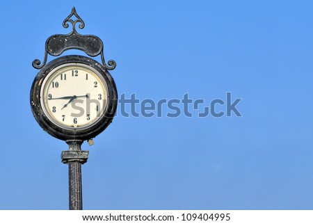An Image of an Antique Clock with space for text - stock photo