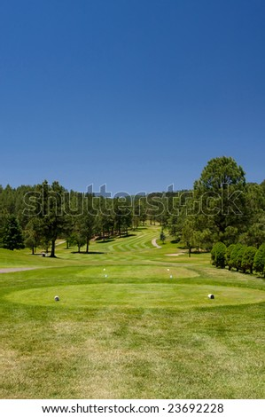 An image of  an Arizona golf course on a bright summer day