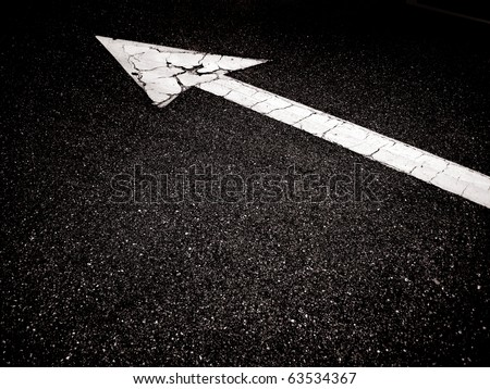 an image of an arrow on the road - stock photo