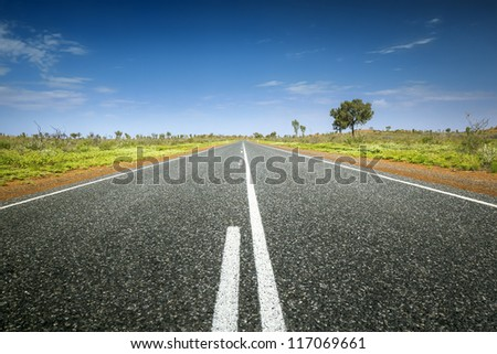 An image of an Australian desert road - stock photo