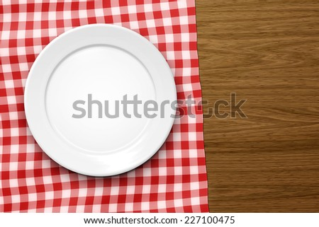 An image of an empty plate on a wooden background