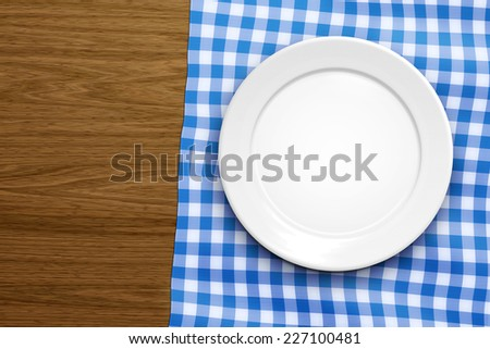 An image of an empty plate on a wooden background - stock photo