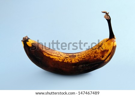 An image of an isolated rotten banana - stock photo