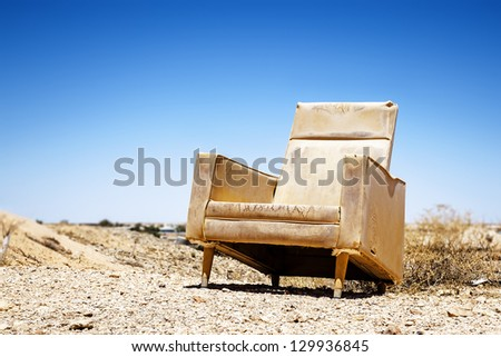 An image of an old chair outdoor - stock photo