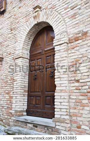 An image of an old door in Italy - stock photo