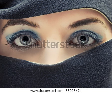 An image of arabian hidden face - stock photo