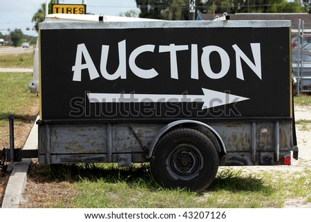 an image of auction sign on green grass