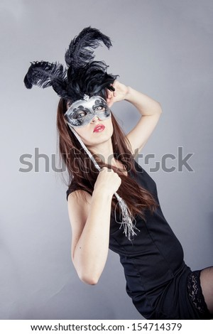 an image of beautiful young girl with venetian mask