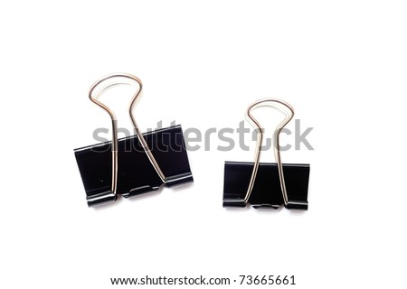 An image of black paper clips on white - stock photo