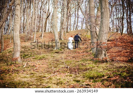an image of bride and groom in forest