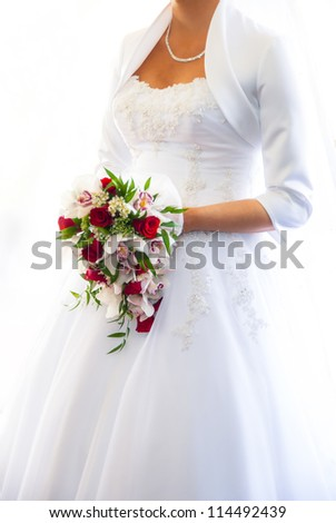 an image of bride holding bouqet - stock photo