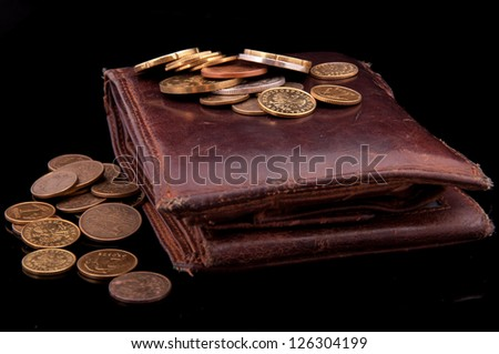 An image of brown leather wallet and polish coins zloty on it - stock photo