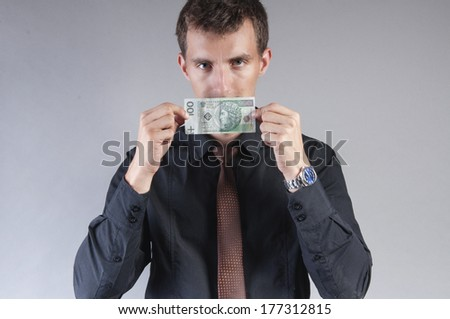 an image of businessman is eating a sandwich with money - stock photo