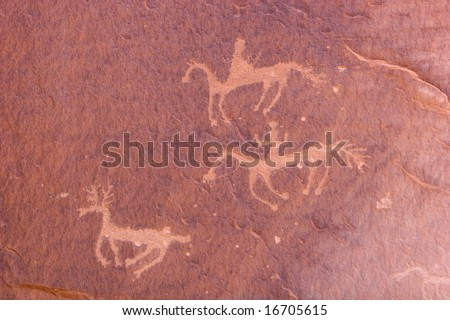An image of carvings and ancient art on canyon walls - stock photo