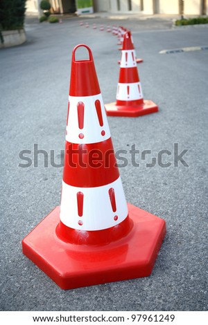 An image of caution cone sign on asphalt road. - stock photo