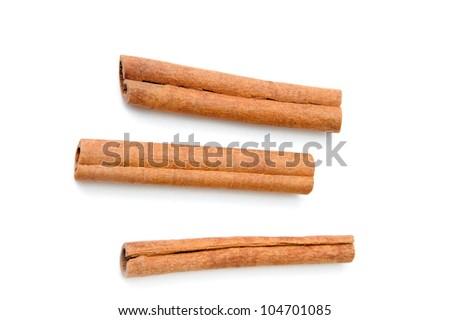 An image of Cinnamon sticks on white background - stock photo