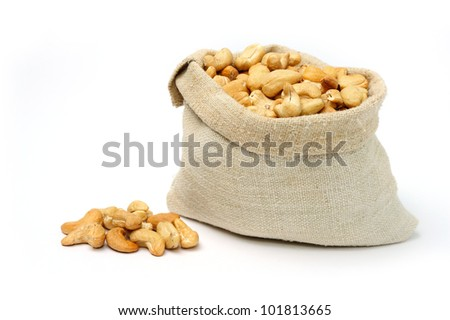 An image of delicious cashew in a textile bag - stock photo