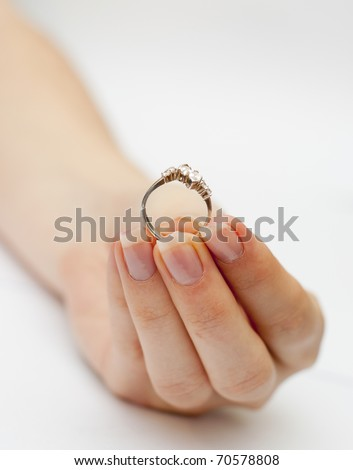 an image of engagement ring held in hand