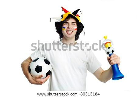 An image of football fan with ball and trumpet - stock photo