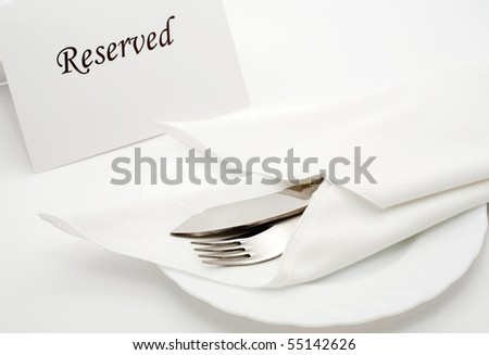 An image of fork and knife in napkin on the table - stock photo