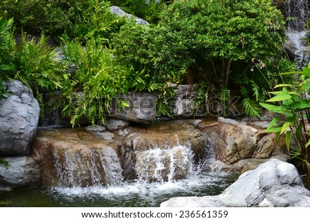 An image of garden waterfall and small pond - stock photo