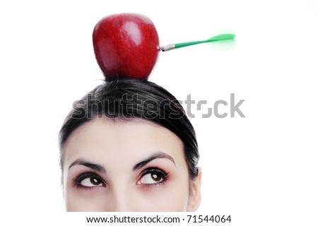 An image of girl with apple on her head. Apple with dart. - stock photo
