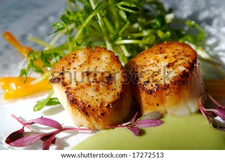 An image of gourmet seared scallops with garnishes - stock photo