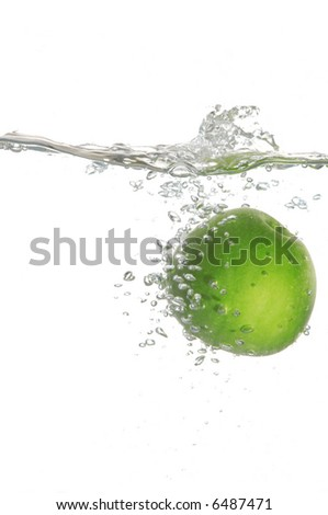 An image of green apple in water