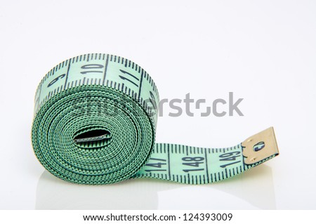 An image of green centimeter on white background - stock photo