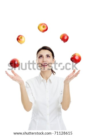 An image of happy young woman playing with red apples - stock photo