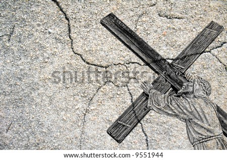 An image of Jesus carrying the cross with a rustic look using layers. Perfect for Easter. - stock photo